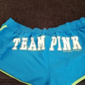 Vintage TEAM PINK polyester swim shorts like new